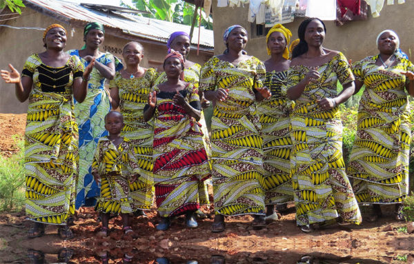 Women from GRACE and the community dance wearing dresses made from matching fabric.