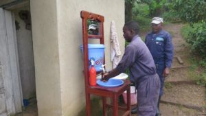 Illustrates staff washing hands during Ebola and COVID-19 outbreaks