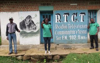 GRACE Educators stand outside the radio station.