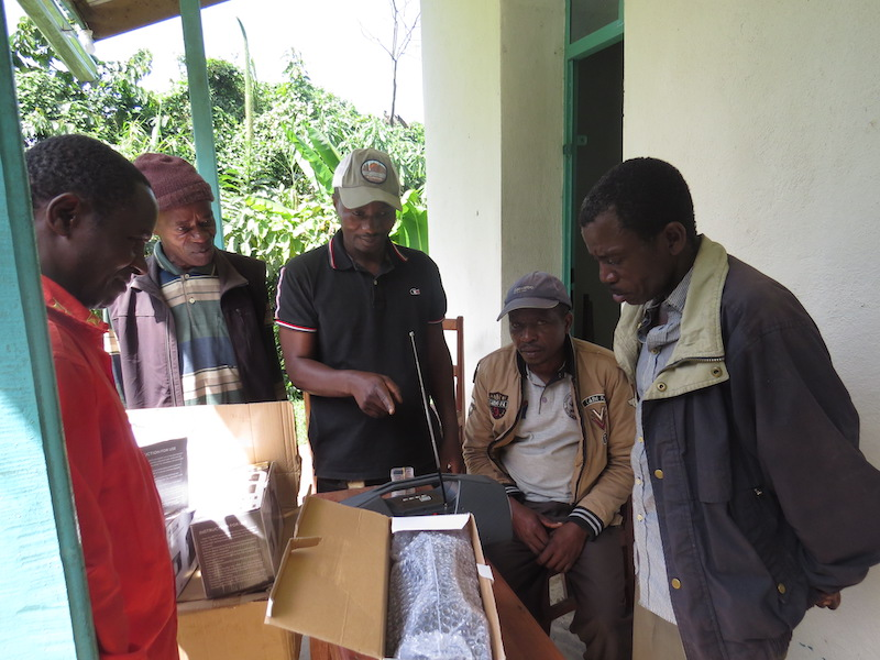 GRACE staff hand out solar-powered radios to leaders of local communities.
