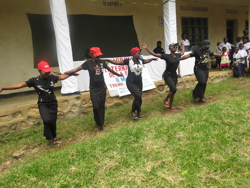 Women in a dance group perform for International Women's Day.